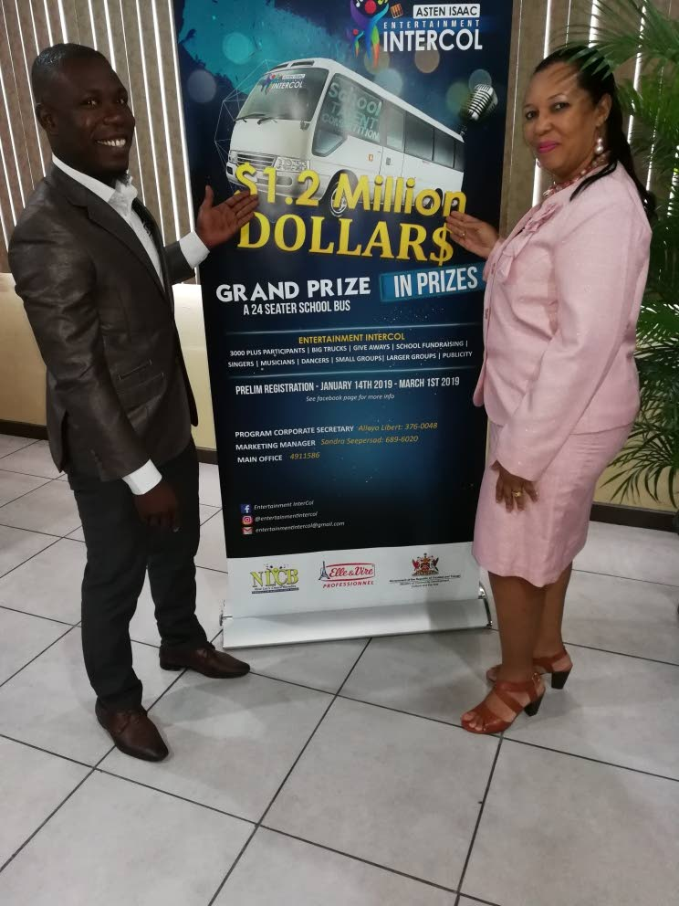 Soca artist Asten Isaac is here with Josephine Torrel-Brown, curriculum officer, visual and performing arts, Ministry of Education at the launch of the Entertainment Intercol competition yesterday at the VIP Lounge of the Queen's Park Savannah