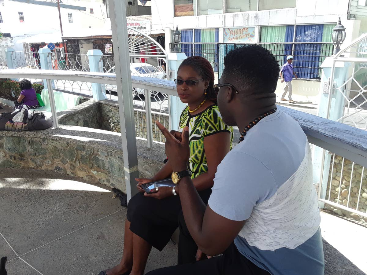 Minority Councilor Faith BYisrael, left, meets with a member of the public at the James Park, Scarborough, on Tuesday morning following a press briefing at the venue.
