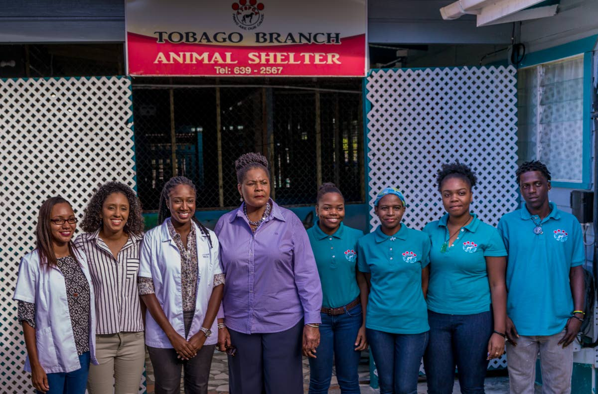 President Paula Mae-Weeks poses for a photo with staff of the Tobago animal shelter (TTSPCA) at Friendsfield Branch Rd in Scarborough Calder Hall during a tour on Tuesday. Photo by David Reid