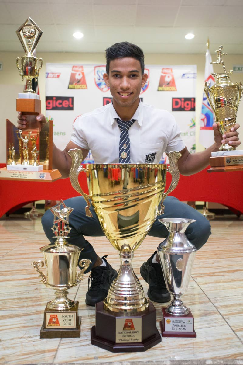 Naparima College footballer Mark Ramdeen poses with his trophies after being honoured at the Secondary Schools Football League awards, at the Couva/Pt Lisas Chamber of Commerce, Couva, yesterday. Ramdeen was voted the Most Valuable Player of the Year (Boys), for 2018.