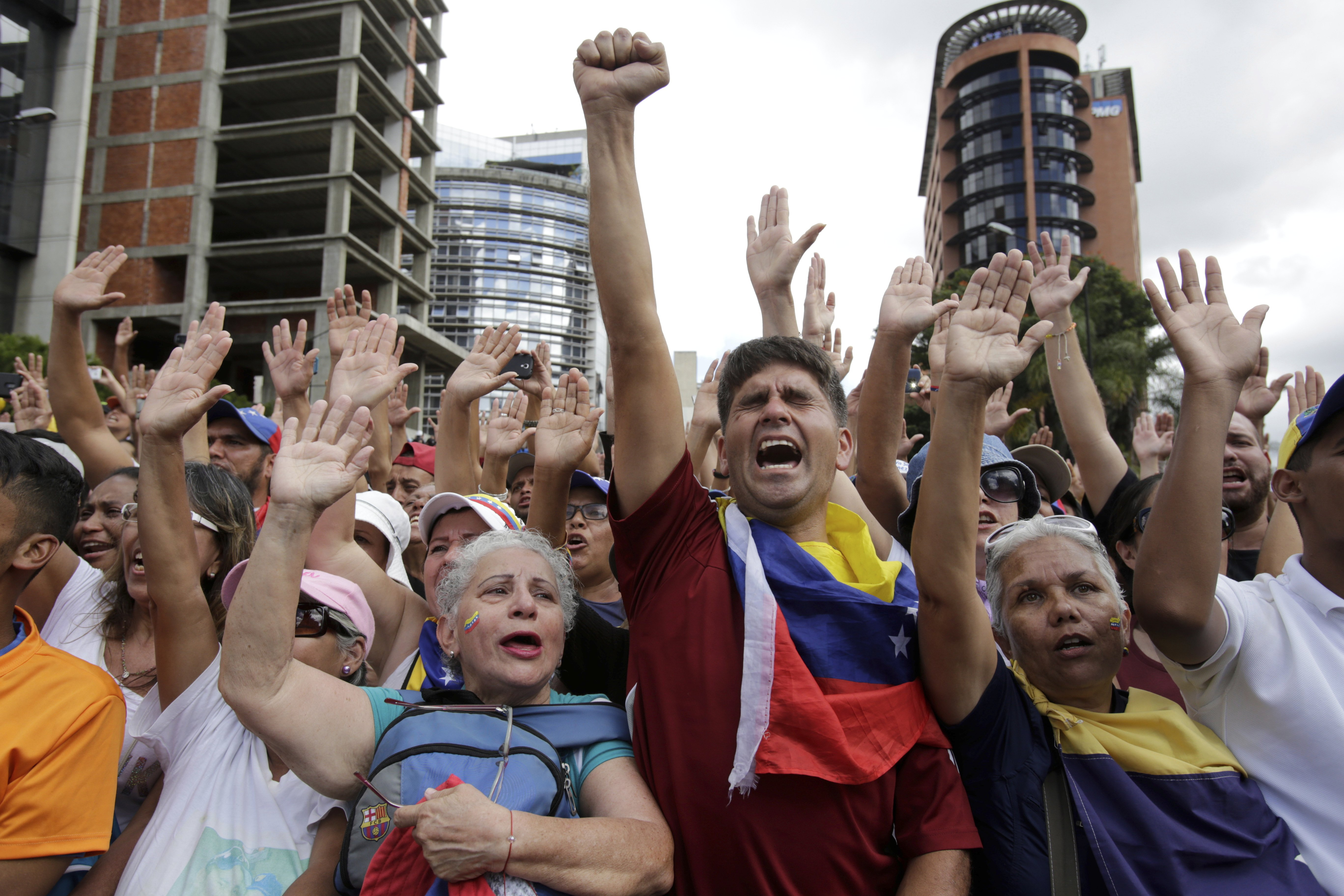 Anti-government protesters cheer after Juan Guaido, head of Venezuela's opposition-run congress, declared himself interim president of the South American country until new elections can be called, at a rally demanding the resignation of President Nicolas Maduro, in Caracas, Venezuela. (AP Photo/Boris Vergara)