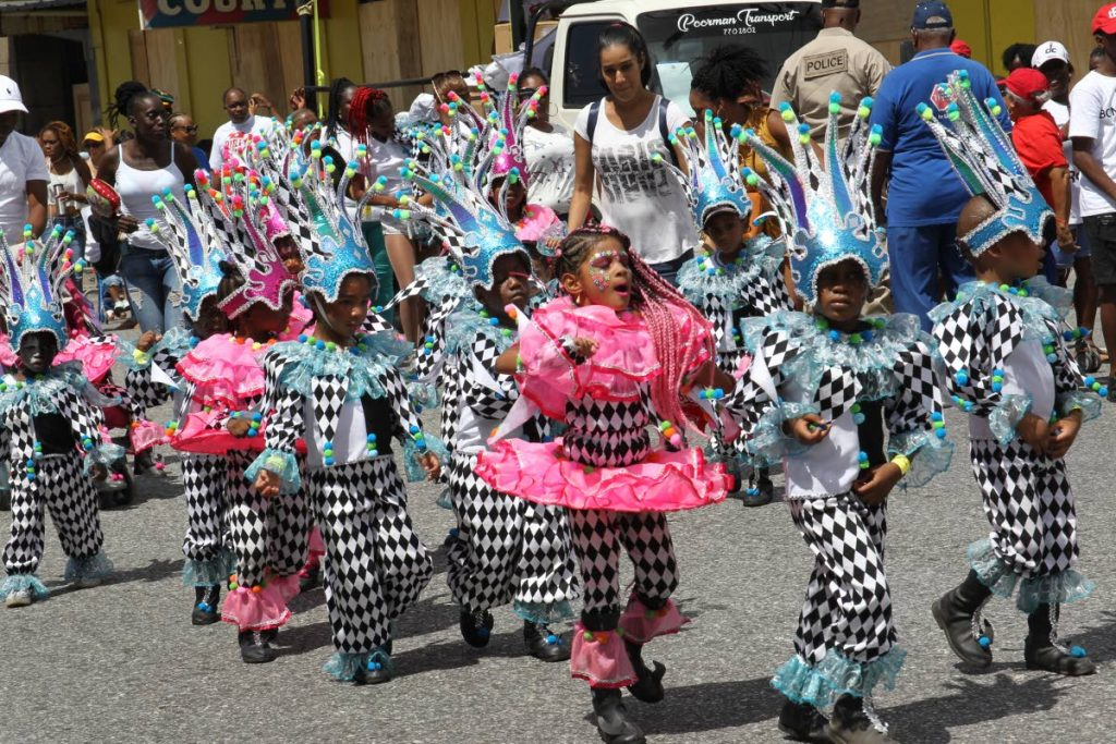 Masqueraders on parade in Carnival Babies' 2018 presentation Ebony and Ivory in downtown Port of Spain. This year will be the band's final presentation after ten years with the 2019 portrayal Celebration Time – Cheers to Carnival Babies Over the Years. FILE PHOTO