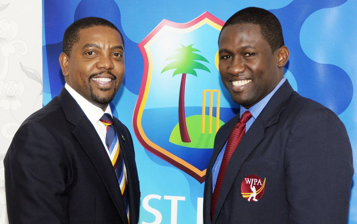 West Indies Players Association (WIPA) president Wavell Hinds, right, with Cricket West Indies head Dave Cameron.