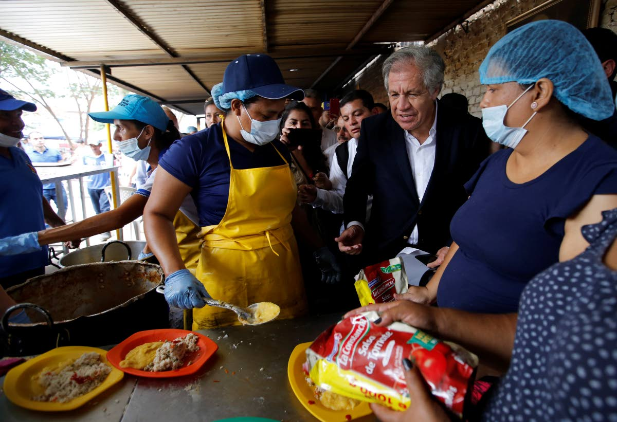 Organisation of American States Secretary General Luis Almagro talks to Venezuelan migrants at the Divina Providencia migrant shelter, in La Parada, Colombia on September 14, 2018. FILE PHOTO