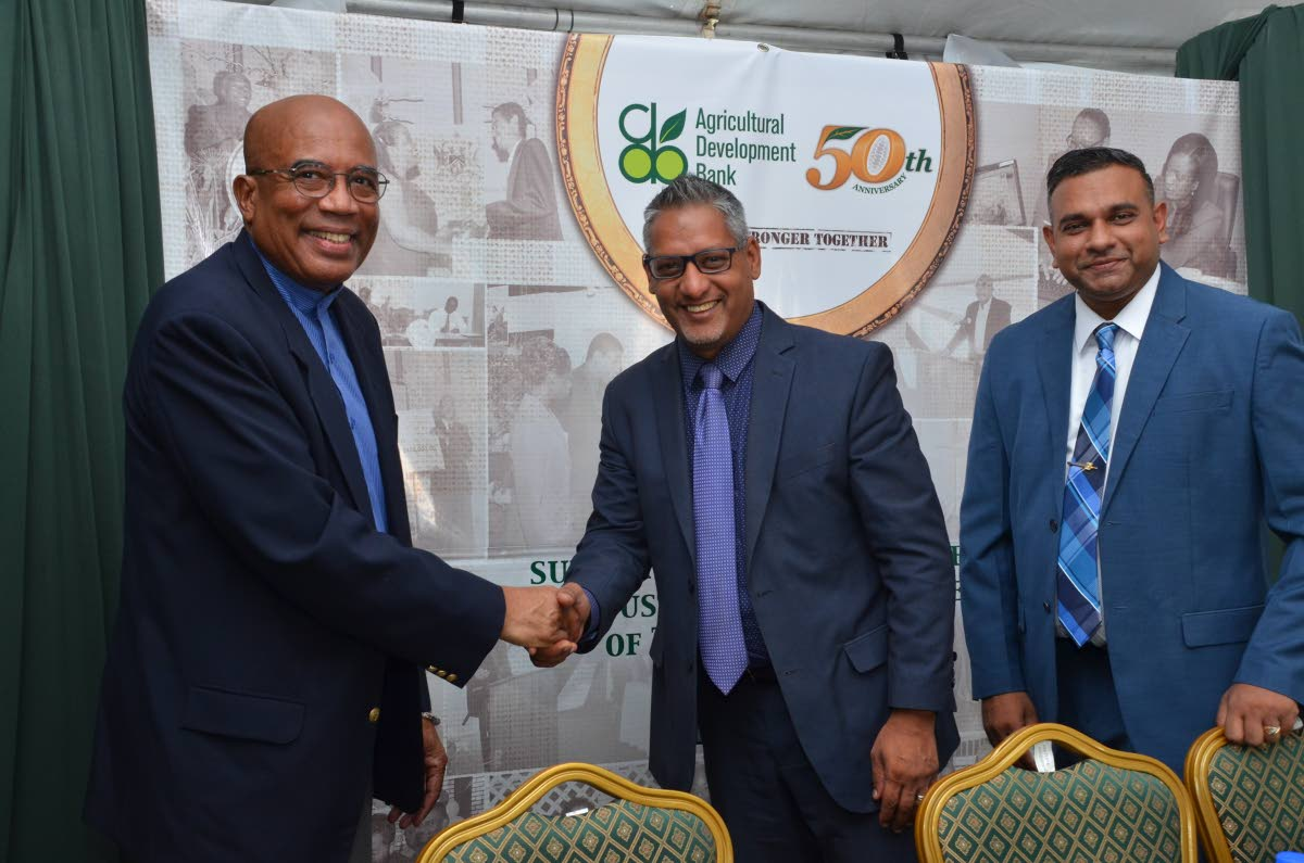 Cepep chairman Winston Rudder shakes hands with Agriculture Minister Clarence Rambharat