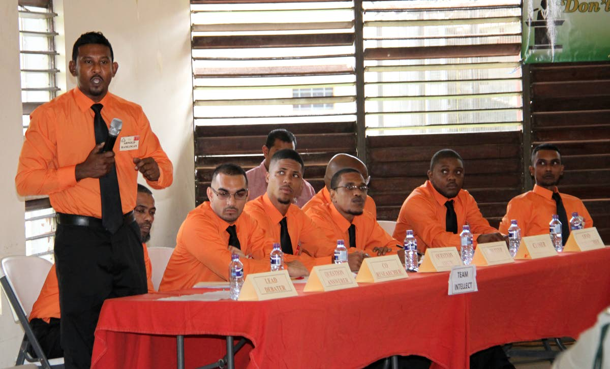 Arnold Ramlogan far left the lead debater for prison inmates debate team, Team Intellect, in the prisons debate finals held at the Maximum Security Prison in Arouca.