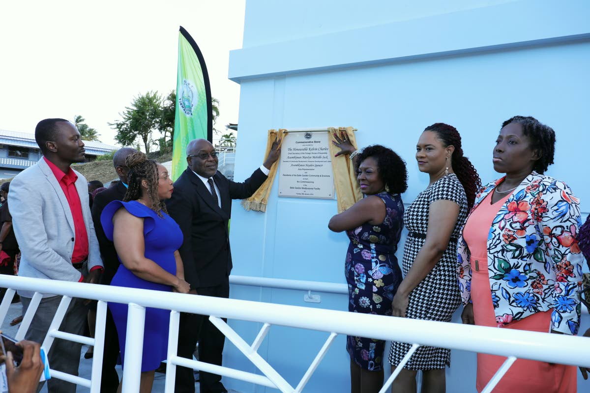Tobago East MP Ayanna Webster-Roy, second from right, and Chief Secretary Kelvin Charles, third from left, participate in the commissioning of the new Belle Garden Multipurpose Facility on Tuesday. Others in photo from left are Assemblyman Ancil Dennis, Community Development Officer Michelle Burris, Secretary of the Division of Community Development Marslyn Melville-Jack, and Community Development Administrator Cherryl-Ann Solomon.