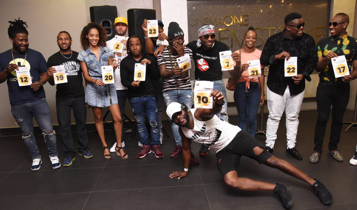 International Soca Monarch contestants strike a pose after picking their performance positions for the semifinals yesteday at One Woodbrook Place, Port of Spain. PHOTO BY KERWIN PIERRE