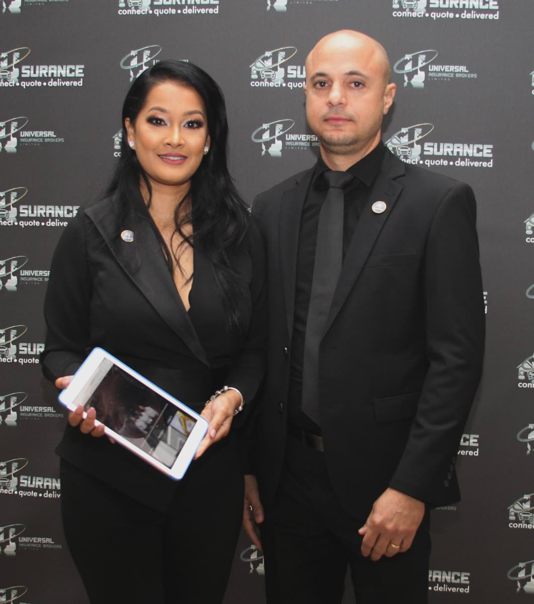 Troy Gabriel, founder of Universal Insurance Brokers Limited(UIBL) and his wife, Melesha, UIBL executive director, at the official launch of Usurance - Online Insurance Solution, from Universal Insurance Brokers Ltd, Hyatt Regency, Port of Spain last Friday.