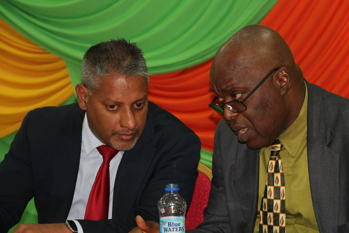 Chief Secretary Kelvin Charles, right, speaks with Agriculture Minister Clarence Rambharath at the Tobago launch of the incentive programme - the National Agricultural Finance Support Programme (Agro-Incentive) last Wednesday at the Division of Community Development, Glen Road Scarborough.