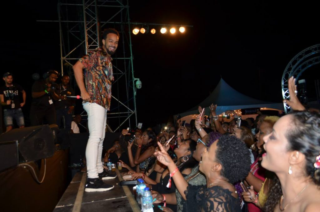 Kees Dieffenthaller charms fans at Gateway to the World at the old Piarco airport car park on February 1, 2019. PHOTOS BY JOAN RAMPERSAD