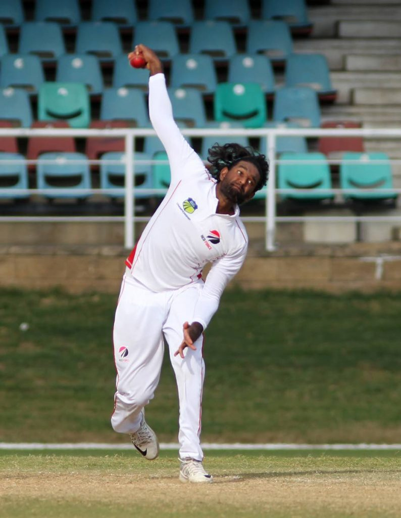 Red Force spinner Imran Khan sends down a delivery against Guyana Jaguars yesterday at the Queen's Park Oval. PHOTO BY ROGER JACOB