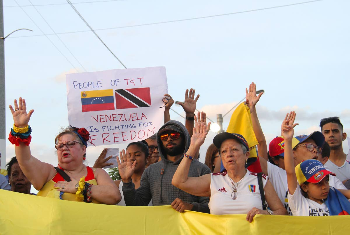 Venezuelans show their support for Juan Guaido as interim president during a rally at Queen's Park Savannah, Port of Spain. PHOTO BY AYANNA KINSALE