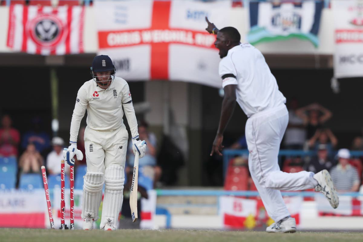 West Indies captain Jason Holder celebrates after he bowled England's Jonny Bairstow on day three of the second Test at the Sir Vivian Richards Stadium in North Sound, Antigua, Saturday. (AP)