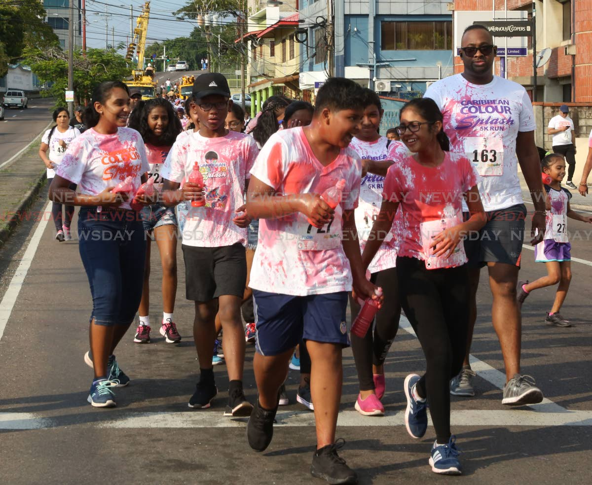 Participants walking during the   Naparima Boys College ,  San Fernando ,  Caribbean  Colour  Splash 5k ,   held by the school this afternoon.  Photo by Vashti Singh
