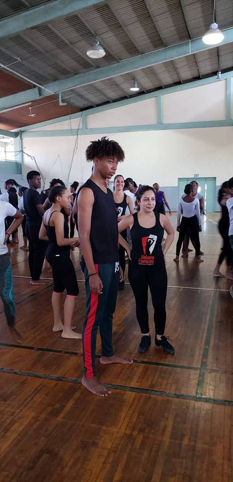 Jaden Forde partners with a Habanas Compas dancer to learn how to salsa.