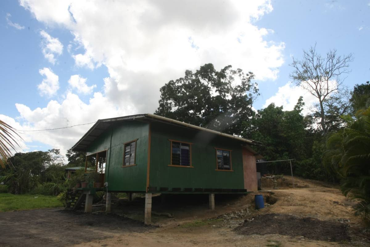 The house in Point Fortin behind which the  a baby girl was found.   PHOTO BY LINCOLN HOLDER
