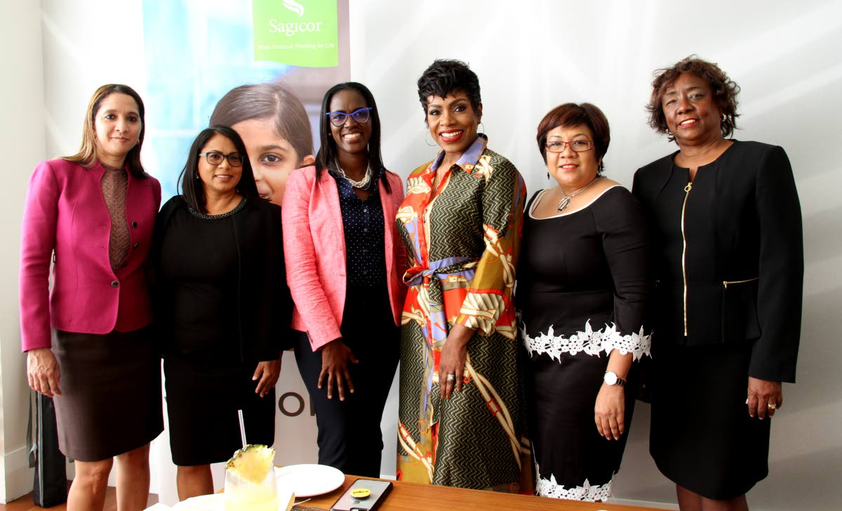 American actress Sheryl Lee Ralph Hughes, third from right, with Sagicor staff at the Hyatt Regency Trinidad.PHOTOS BY CHOLAI