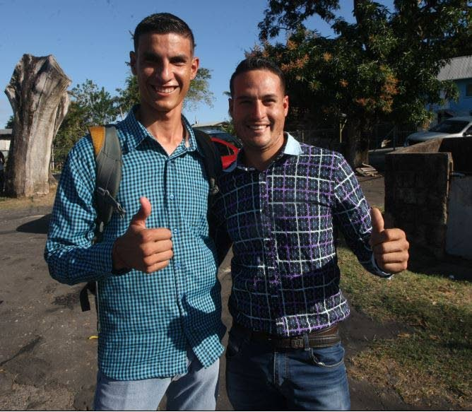 Noe Rodriguez, 23, left, and his cousin Jonniel Rodriguez, 21, smile for a photo at Cedros on Monday.