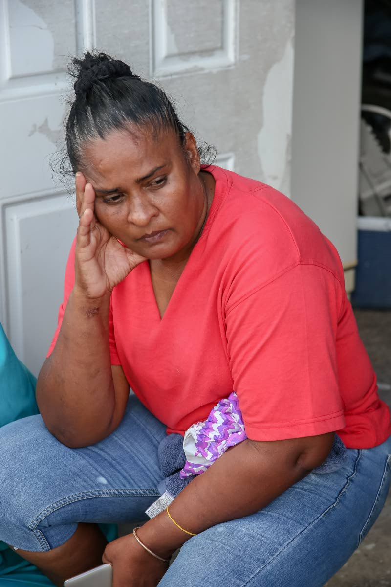 Doreen Allan, mother of slain Muhammad  Allan, remembers her last moments with her son at her home on Circular Drive, Crown Trace,  Chaguanas,  yesterday. PHOTO BY JEFF K. MAYERS