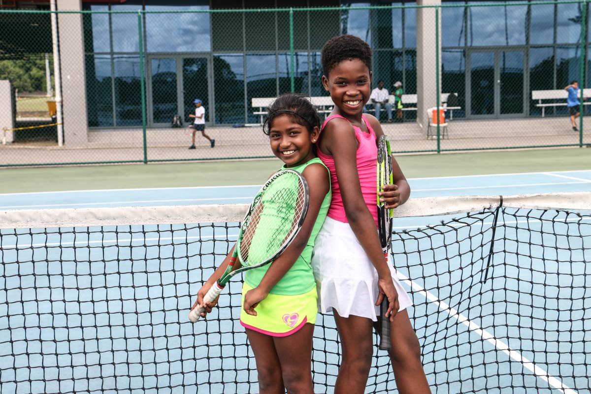 Naomi Mohammed, left, and Tianna Richardson have been playing lawn tennis since they were three. PHOTOS BY RIHANNA McKENZIE