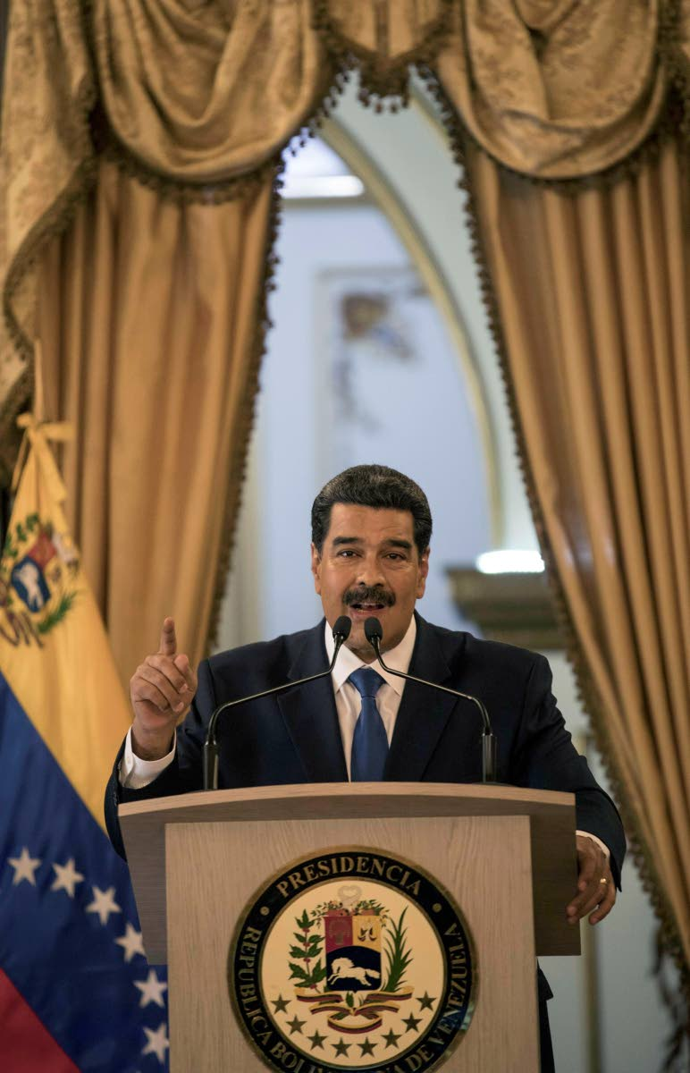 Venezuela's President Nicolas Maduro talks during a press conference at Miraflore's Presidential Palace in Caracas, Venezuela, on Friday. AP PHOTO