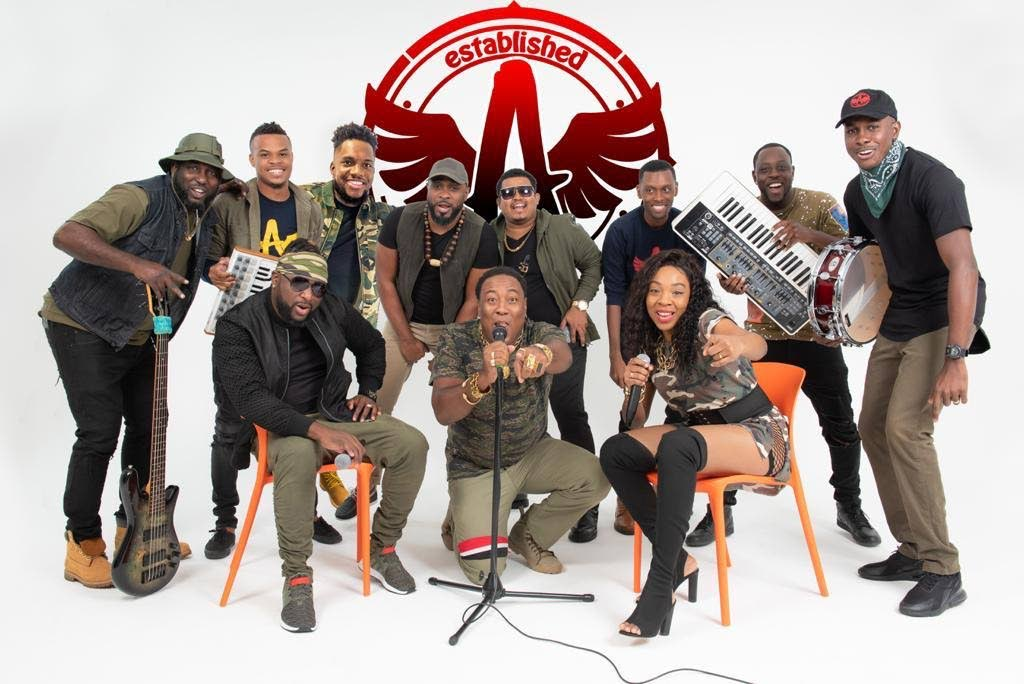 """The A Team band with lead vocalists Eddie Charles (front centre) and Kerlene """"Ms Kerlz"""" Joseph."""