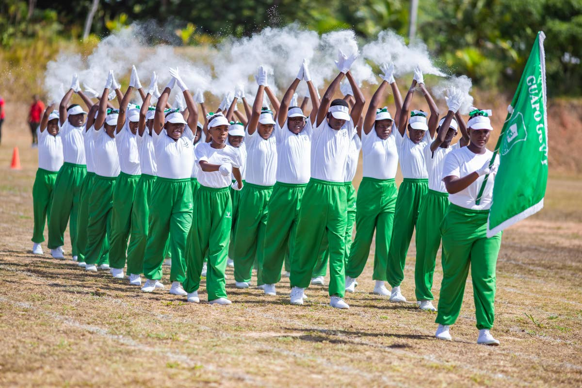 CHAMPIONS: Guapo Government shows off their winning routine in the march past at the La Brea Zonal Primary Schools Games on Thursday at Sobo Recreation Ground, La Brea. PHOTO COURTESY NATIONAL ENERGY