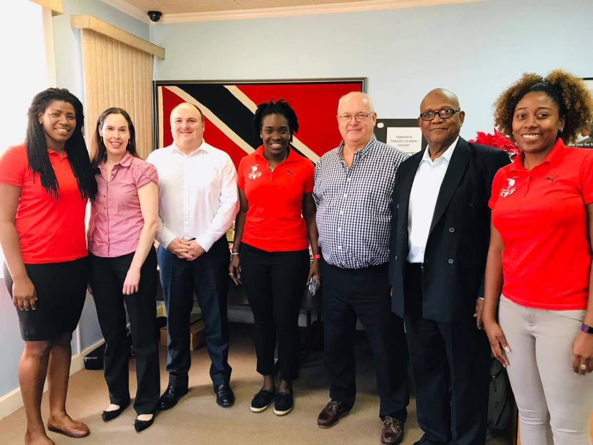 TT's Commonwealth Youth Games 2021 bid team Rheeza Grant, left, Kwanieze John, centre, and Chanelle Young, right, with members of the Commonwealth Games Federation evaluating committee in Trinidad earlier this week.
