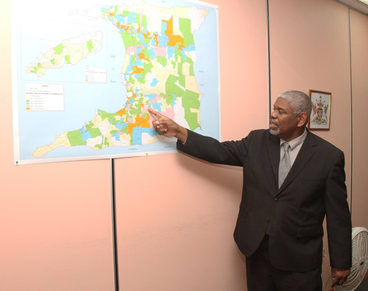 Director of Statistics, Sean O'Brien points to a map of Trinidad and Tobago at his Central Statistics Office (CSO) Duke Park Street, Port-of-Spain. Photo by Ayanna Kinsale