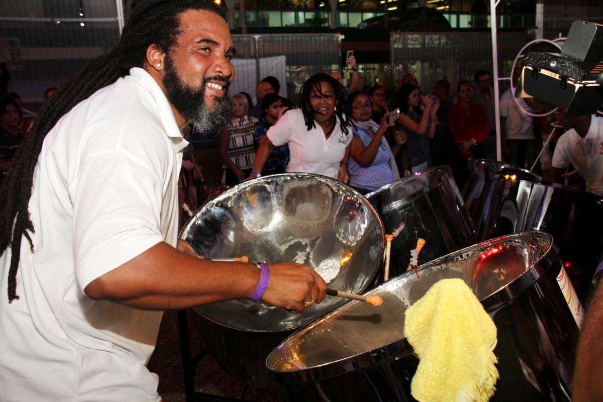 A CAL Skiffle pannist whips up the vibes for supporters at the band's panyard, Coffee Street, San Fernando on Friday night. PHOTO BY CHEQUANA WHEELER