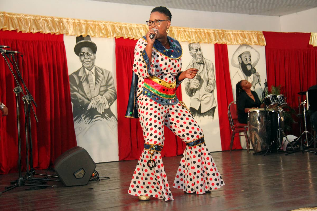 Victoria Cooper Rahim, also known as Queen Victoria, gives the audience a taste of her lyrical skills at Kaiso Showkase Palm's Club, San Fernando on Friday night. PHOTO BY CHEQUANA WHEELER
