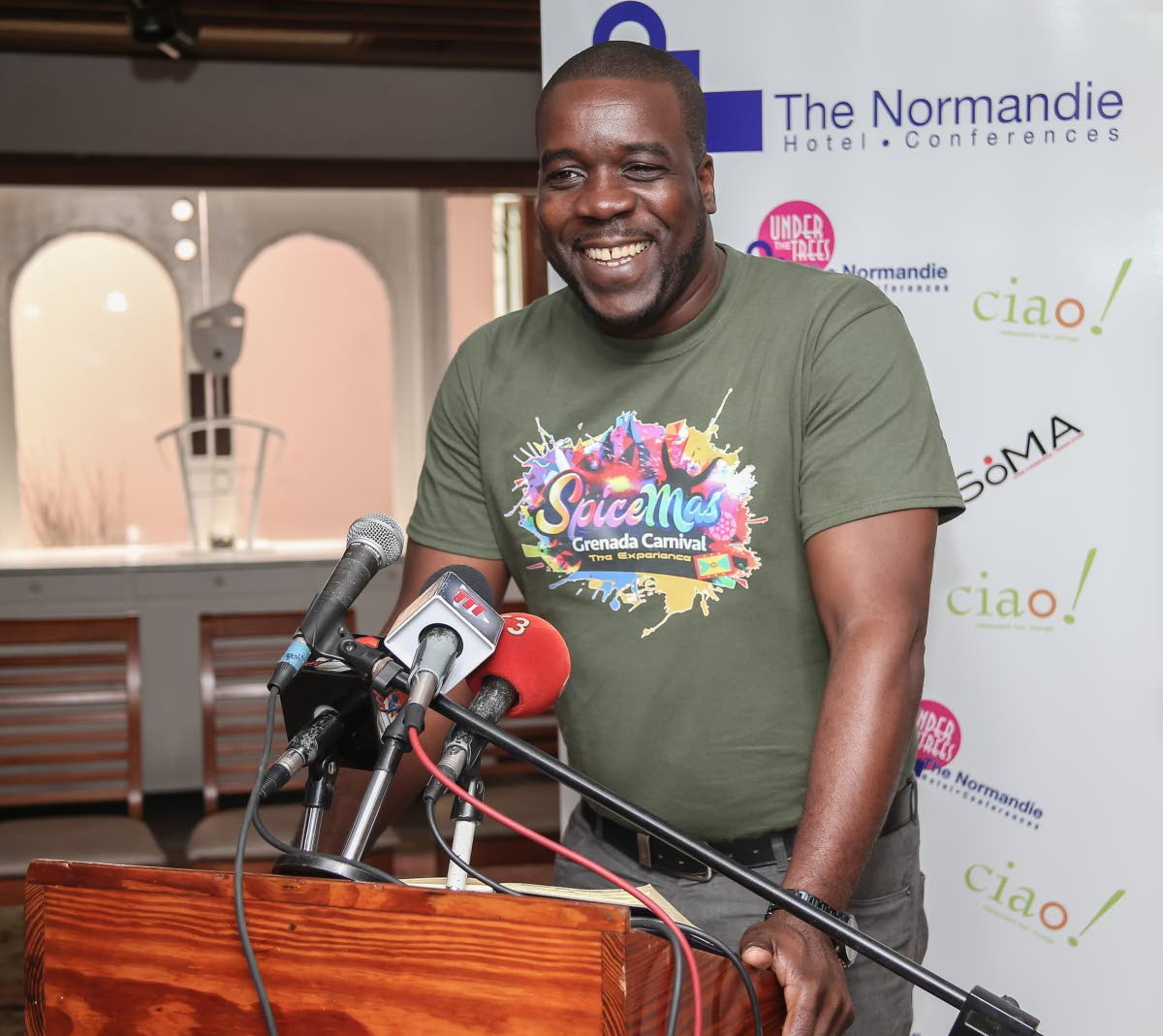 Grenada's Minister of Youth, Sports, Culture and the Arts, Norland Cox addresses a media conference at The Normandie, St Ann's yesterday. PHOTO BY JEFF MAYERS