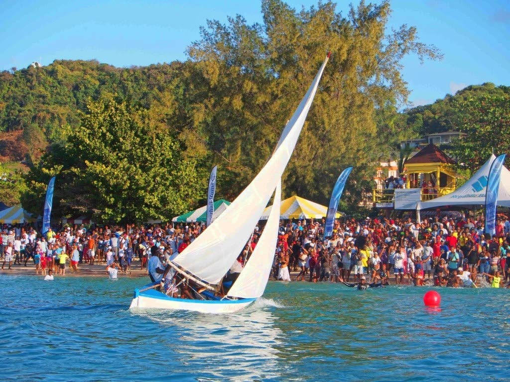 Ah Doh Know sails to victory before a huge crowd at the Grand Anse Beach, during the Grenada Sailing Festival Workboat Regatta.