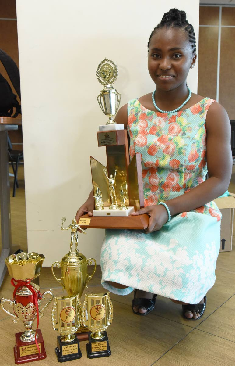 Chequeda De Boulet poses with her trophies for the Junior and Senior Female of the Year, at the TT Badminton Association's awards ceremony,on Saturday, at the National Racquet Centre, Tacarigua. PHOTOS BY KERWIN PIERRE