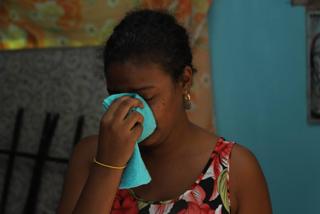 Akesha Allicock breaks down in tears following the death of her husband Allister Pierre yesterday. PHOTOS BY JEFF MAYERS