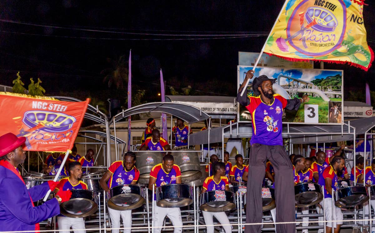 Moko jumbies dance to the music of NGC Steel Xplosion as pannists perform before the judges for the preliminary round of Panorama at its Buccoo base.