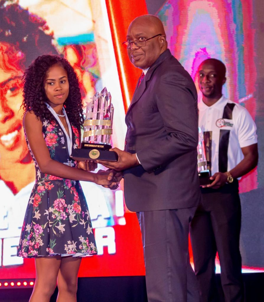 Netballer Kalliyah Stephen receives her ward for 2019 Sportswoman of the Year from Chief Secretary Kelvin Charles at the (THA) Sport Awards last Thursday evening at the Magdalena Grand Beach and Golf Resort in Lowlands.  Photo by David Reid