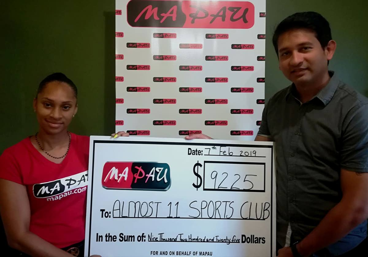 Ma Pau representative Kerry-Ann Thompson, left, presents a cheque to Almost 11 Sports Club executive member Ravi Johnson.