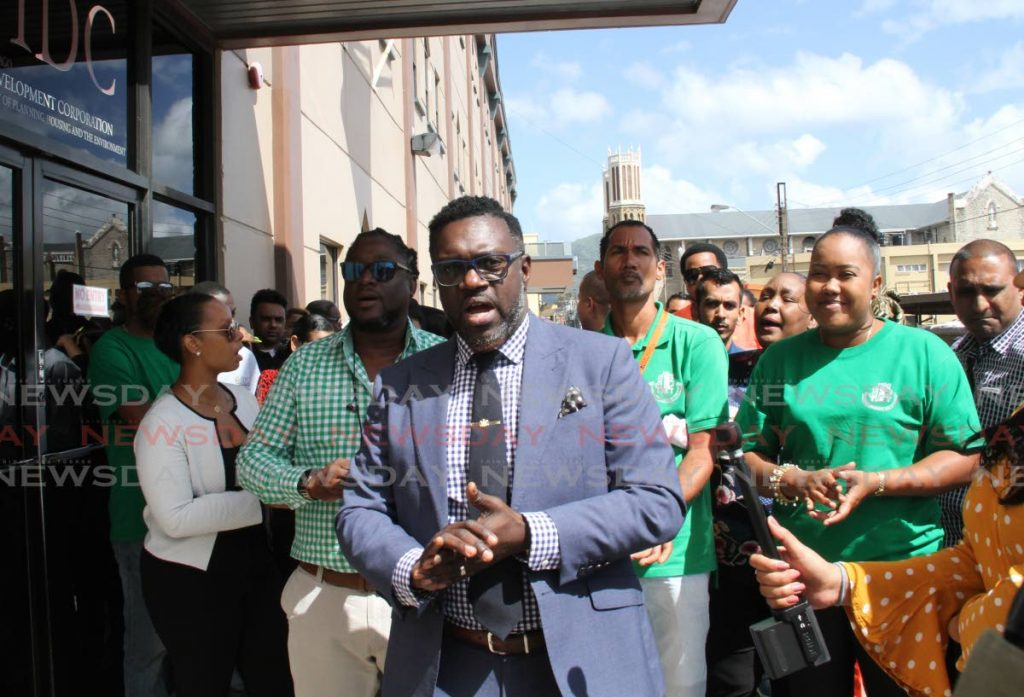 PSA president Watson Duke middle, outside HDC's head office in South Quay, Port of Spain, with monthly paid HDC's employees protesting. PHOTO SUREASH CHOLAI