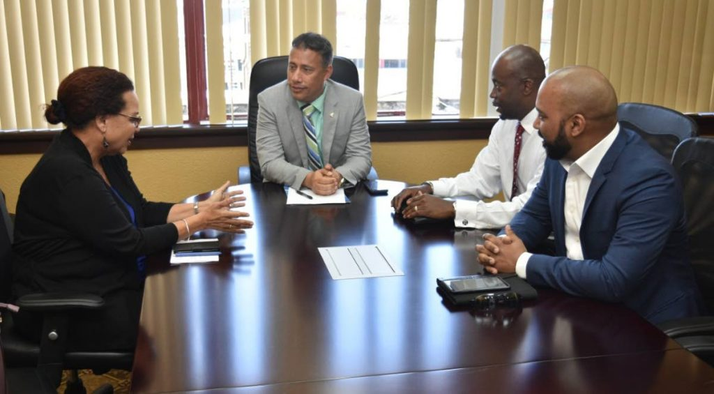 LET'S TALK: Commissioner of Police Gary Griffith, centre, during a meeting last Wednesday in Port of Spain with officials from three tourism stakeholder organisations. On that day, a British couple was held up at gunpoint and robbed in Tobago.