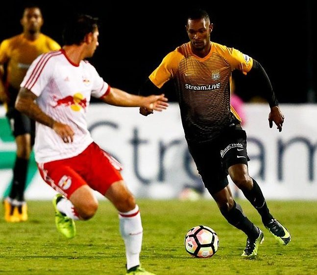 Charleston Battery forward Atualla Guerra, right, is nominated for the First Citizens Sports Foundation Awards.