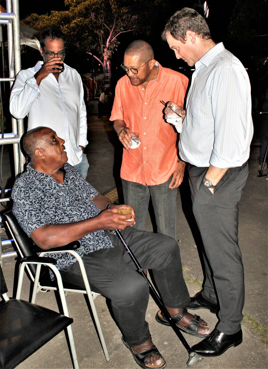 Carlos John and Proman CEO David Cassidy with Ken Julien (seated).
