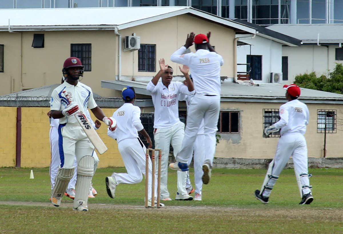 Presentation College players celebrate the dismissal of Naparima's Cephas Cooper, left, in a Powergen Secondary Schools Cricket League match at Presentation College Ground, Chaguanas, yesterday.