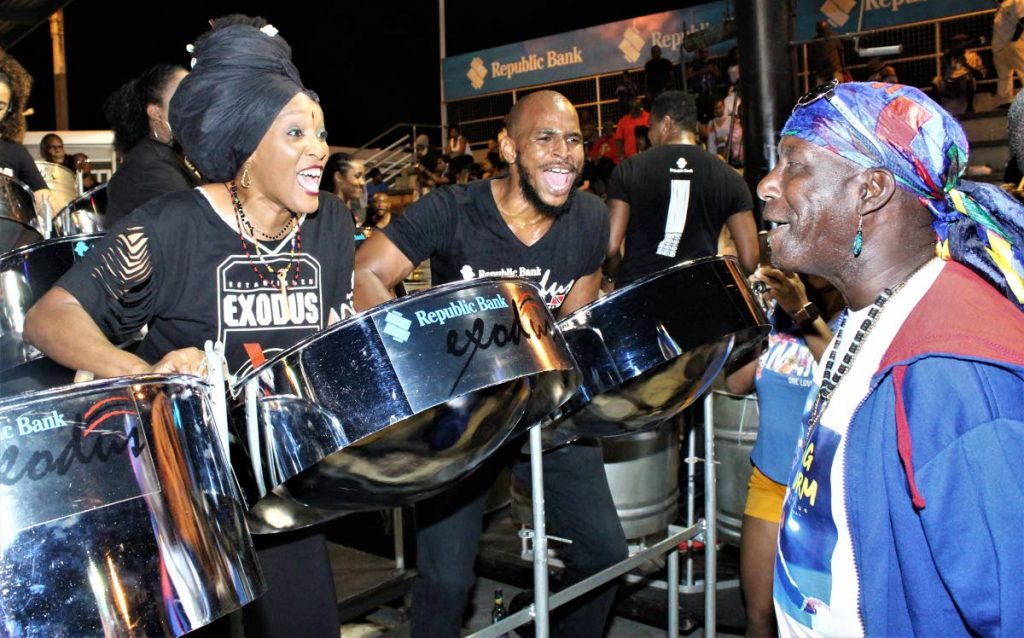 Highly animated Exodus players Jamaal Lewis, centre, and Lisa Mc Clashie react on seeing soca veteren Austin