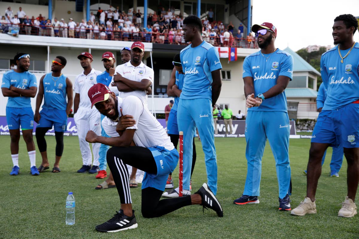 West Indies' Roston Chase smiles during the presentation after day four of the third cricket Test match between England and West Indies at the Daren Sammy Cricket Ground in Gros Islet, St. Lucia, on Tuesday. England won by 232 runs but West Indies won the series 2-1.