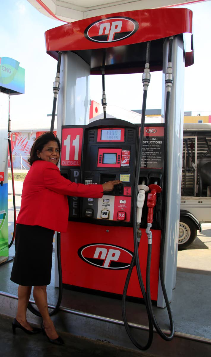Minister of Trade and Industry Paula Gopee-Scoon points to the Fuel Verication Sticker on the fuel pump at the NP Munroe Road Service Station, Charlieville, on Wednesday. Photo by Vashti Singh