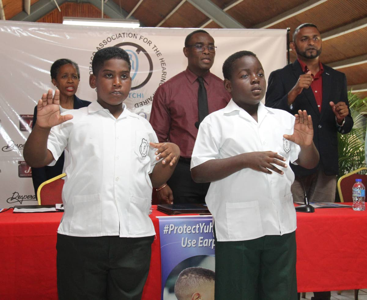 Students of the Cascade School for the Deaf sign the National Anthem at the launch of the Protect Your Ear national awareness campaign at the Dretchi compound, Wrightson Road, Port-of-Spain Wednesday. PHOTO BY AYANNA KINSALE