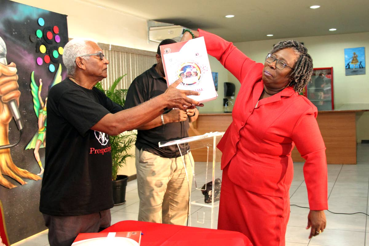 PAN POSITION PICKS: Pan Trinbago's president Beverly Ramsey-Moore picking for Tobago band Alpha Pan Pioneers playing position in Saturday's small bands finals. She picked number from the box held out by Pan Trinbago's trustee Keith Simpson at NCC VIP lounge, QP Savannah. PHOTO BY SUREASH CHOLAI
