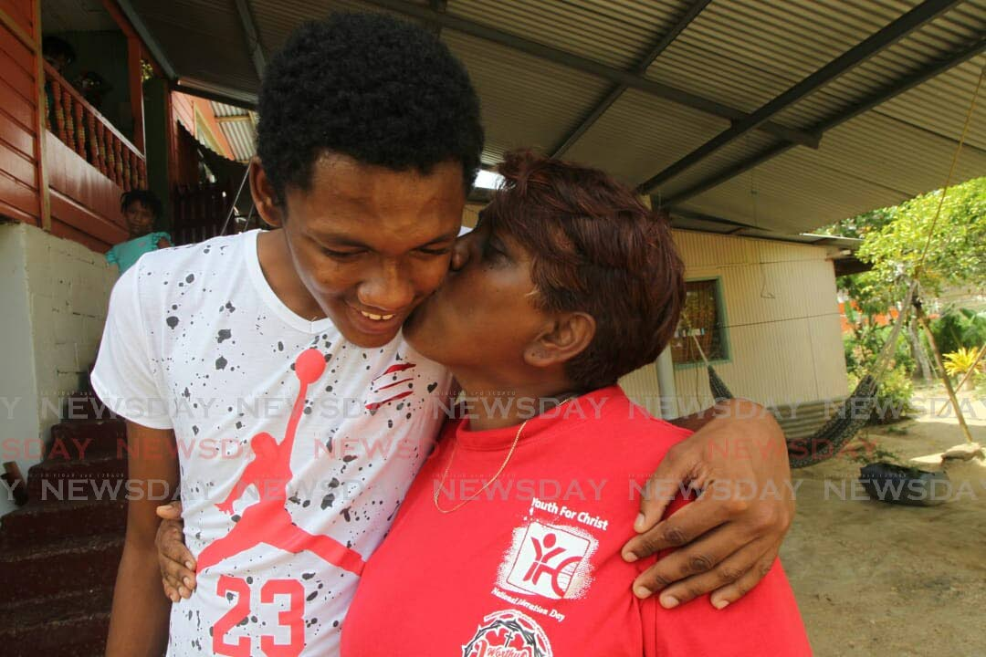 Kenrick Morgan and his mother Linda Boodoo.  Photo: Lincoln Holder